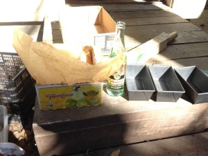 an empty Topo Chico box with parchment paper